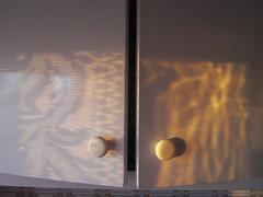 sunrise direct light & reflected light (the incredible how (intermitten.t)) Tags: door light shadow espaa handle amanecer cupboard menorca baleares minorca balearicislands illesbalears reflectedlight salidadelsol 9182 samesquida sortidadelsol alternativesunrise 06102012