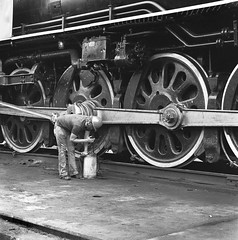 Union Pacific 4-8-4 FEF-3 class Northern oil burning steam locomotive 8444, is  being greased in the yard at Denver, Colorado, Summer 1980 (alcomike43) Tags: old railroad blackandwhite bw classic modern yard vintage photo engine trains historic grease negative photograph maintenance unionpacific service locomotive steamengine denvercolorado steamlocomotive 484 alco oilburner railroadyard 844 passengertrains 8444 locomotiveservice railfanexcursiontrain fef3class denveryard
