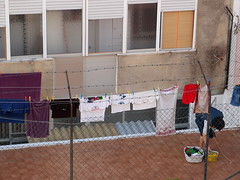 laundry day (knesje) Tags: city urban woman portugal apartment flat terrace clothes patio housework laundry clothesline housewife washingline amadora