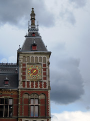 The tower of the Central Station in Amsterdam, Holland has a wind vane (albatz) Tags: centraal train railroad station track centralstation amsterdam holland tower building