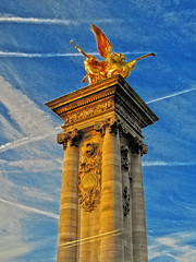 Parisian Twilight (John Jardin) Tags: paris statue column twilight shadows sculpture sky blue gold golden clouds up view