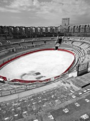 Arles Amphitheatre (AmyEAnderson) Tags: coliseum arles france provence bouchesdurhone historic roman romanesque tower seats bleachers oval ring monochrome bw blackandwhite numbered numbers red clouds unesco