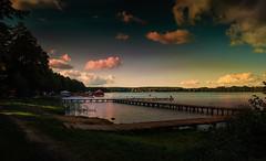Pier on the lake. (augustynbatko) Tags: pier lake water nature sky clouds landscape polska