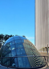 bubble (Harry Halibut) Tags: blue sky reflection building london glass lines station underground steel curves tube entrance wharf canary stainless allrightsreserved londonbuildings londonarchitecture anglesanglesangles imagesoflondon colourbysoftwarelaziness 2012andrewpettigrew london1207062411