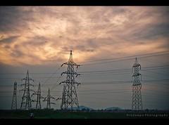 Power grids (Pradeepa Pandiyan) Tags: red sky india clouds grid dawn evening power chennai tamilnadu