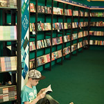 Boy reading in the children's bookshop