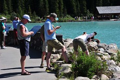 Lake Louise (D70) Tags: world park people mountain lake canada heritage closeup standing photography site phone close some cell scene front unesco most louise national alberta when attractive worlds what banff addiction distracted communicating