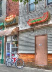Squeeze In_tonemapped (podolux) Tags: street signs bicycle sign restaurant hotdog nikon neon pennsylvania fastfood pa neonlights neonsign nikkor 2012 neonsigns arrowsign sunbury hotdogjoint photomatix tonemapped tonemap squeezein d5100 august2012 nikond5100 nikkordx1855vr photomatixformac