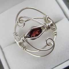 Garnet and Sterling Filigree Ring (AshleighAnnette) Tags: red brick stone silver blood wire wrapped ring faceted sterling scroll oval gem garnet filigree