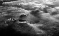 Mountain Flow (cormend) Tags: mountains fog alaska clouds canon airplane landscape eos flight 50d cormend