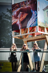Thames Festival 2012 - 27 (garryknight) Tags: 1855mmvr 2012 55200mmvr creativecommons d5100 london nikon southbank thamesfestival balcony lightroom poster sunglasses three woman