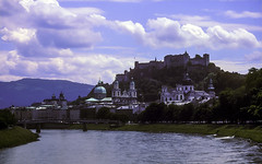 Old Town & Hohensalzburg above the Salzach River (woodchuckiam) Tags: oldtown hohensalzburg salzachriver salzburg austria churches domes steeples castle fortress river riverbank trees bridge sky clouds scenic landscape woodchuckiam