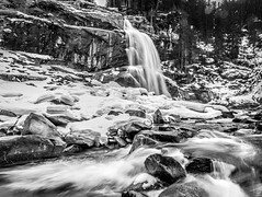 Staircase of water, Krimml Austria (Simon van Ooijen) Tags: waterfall black white bw krimml austria oostenrijk europe fall waterval zwartwit zwart wit beautiful nikon iso d90 camera skiing holiday vacation mountain alps alpen bergen composition landscape landschap simon ooijen photography rocks cliff trees bomen rotsen klif snow sneeuw winter