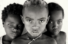 Madagascar, young children (Dietmar Temps) Tags: africa afrika afrique madagascar tribes ethnic ethnology ethnie culture tradition traditional ritual people faces kids children girls remotevillage outdoor fishingvillage morondava morombe tulear vezo sakalava 50mm eyes portrait boy