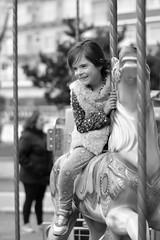 _DSC0163 (ramirofmunicoy) Tags: girl nia plaza calecita mardelplata blancoynegro blackandwhite byn bn bw retrato caballo juegos parque alegria