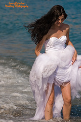 Anna. On the Beach. Wedding in Spain (Jenny Rainbow_PhotoSessions) Tags: blue wedding sea woman love wet water girl hair groom bride togetherness spain nikon couple honeymoon longhair happiness together beautifulwoman breeze weddingceremony d300 honeymooners weddingphotography modelrelease wetdress jennyrainbowartphotography jennyrainbowweddingphotography