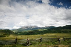 ranchlands (sharwest) Tags: ranch grass clouds fence colorado view splitrail hastingsmesa