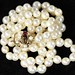 4038. Estate Opera Length Pearl Necklace with Gem Set Clasp