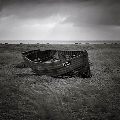 Fishing Boat (dougchinnery.com) Tags: abandoned film grass square mono boat wooden kent fishing shingle dungeness disused hassleblad ilford 500cm panf50