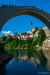Mostar - Death-Defying Dive from Stari Most to Neretva River (Yen Baet) Tags: old city trip travel bridge vacation people water architecture river photography photo ancient europe european cityscape view mostar bosnia postcard diving tourists unesco worldheritagesite restoration diver ottoman tradition picturesque oldtown reconstruction starimost rehabilitation oldbridge bosniaandherzegovina studenci ljubuski neretvariver bosniaihercegovina ljubuki koskimehmedpashamosque vitaljina yenbaet trebizatriver trebiatriver croatbosniakwar