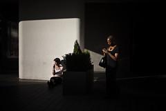 MONOCHROME (Chak!) Tags: life light summer sunlight london dark observation streetphotography cellphone daily smoking mobilephone rest commuting 2012 elegance urbanphotography nikond200 twowoman