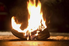 Burning Shoe (The Rondo Theatre) Tags: horizontal blackbackground outdoors fire photography nobody burning sneaker concept copyspace bizarre athletesfoot colorimage