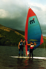 Hitching across Loch Ard 1986 (Doug_Cook) Tags: old water club forest scotland photos resort hills instructors windsurfing loch watersports 1986 trossachs wetsuits windsurf tuition aberfoyle mistral dougcook lochard kinlochard lochardforesthillshotelwatersports trossachsclub foresthillshotelkinlochard