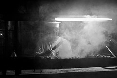 Today's Special: Smoked Chef (Le*Gluon) Tags: street bw night restaurant evening smoke cook chef barbecue tajikistan skewer shashlik khujand d90 tadjikistan tamron18270