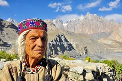 An old women in Upper Hunza behind you can see Tupopdan Peak (6106- M). (Karrar Haidri) Tags: