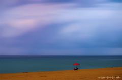 Speechless (philipleemiller) Tags: clouds hawaii pacificocean kauai redumbrella pacificislands longexposures polihalebeach barkingsands d7000 magicunicornverybest trueexcellence1