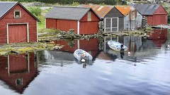 Tranquil (halifaxlight (away until late May)) Tags: sea norway reflections boats grey coast rust rocks cove lichen sheds radoy bovagen