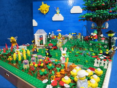 Lego Spring Garden (Mrs Wobblehead) Tags: flowers sky sun tree vegetables grass clouds garden fishing pond lego greenhouse lawnmower hopscotch sunbathing appletree moc swingball springgarden vegetablepatch minifigures