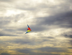 Flying free (PaulE1959) Tags: kite cloud cloudy seaside vacation wind windy colourful blue red purple yellow ominous relaxing sport hobby d5200 nikon
