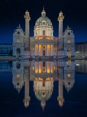 Faith and illusion (Pietro Faccioli) Tags: architecture art austria baroque blue building buildings church columns dome downtown façade glow glowing historical karlskirche karlsplatz lights magic mirror monument night reflection sky square starry urban vienna water neoclassical pietrofaccioli faccioli pietro surface fountain outdoor star stars
