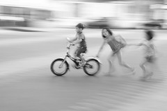 play (l_napishvili) Tags: children playing bycicle move action motion blackandwhite street people
