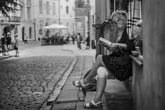 Reading on the street (Georgi C) Tags: read reading street streetphotography streets lonelypeople people talin estonia blackandwhite bokeh bw monochrome voigtlandernoktonclassicf14 nokton sonynex5r