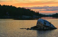Twilight Time (Lindaw9) Tags: shanty bay twilight clouds sky rock treeline landscape