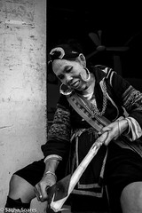 Hilltribe_woman_cuts_sugarcane (sachasplasher) Tags: sapa vietnam hilltribe woman sugar cane machete mama ti tribe