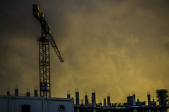 Sun down on construction (tootdood) Tags: canon70d manchester newislington sun down construction sunset orange glow tower crane
