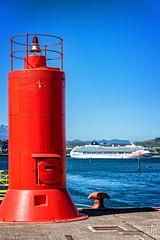 Lighthouse with Norwegian Sun (hapePHOTOGRAPHIX) Tags: 152chl amricadelsur architektur chile leuchtturm loslagos nikond750 puertomontt southamerica sdamerika turm faro hapephotographix lighthouse tower ncl norwegiansun rot red rojo xregin cl