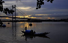 Peaceful (mala singh) Tags: water sunset boat hooghly river kolkata india westbengal reflections bridge
