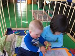 Assistant (kayatkinson-simson) Tags: maya kane 7monthsold playpen greenfloor brotherandsister siblings drawing