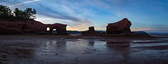 "Sunset pano of the ""islands"" at Medford, NS. (Nancy Rose) Tags: medford novascotia paddysisland beach bayoffundy lowtide sandstone rock oceanfloor sandandmud moonrise sunset rockformations 7495pano2"