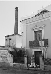 Faro, Igreja de So Pedro. (joshuacolephoto) Tags: street adventure streetphotography sun ilford xp2 bw blackandwhite bnw beauty candid framing noir contrast faro portugal streets explore travel man walking film 135 35mm capture life