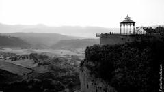 Viewing platform over the hills of Ronda (florianweixlbraun) Tags: schwarzweiss blackwhite viewingplatform cliffs rocks hills ronda spain andalusia landscape panorama romantic klippe fels aussicht hgel andalusien romantik landschaft pavillon dusk silhouette skywalk