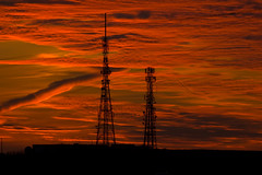 Sunset Transmission (Richard Amor Allan) Tags: sunset red sky sun clouds aerial stokeontrent masts staffordshire antenna fenton transmitters