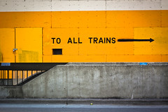 to all trains (is it that obvious) (thermophle) Tags: california yellow wall train oakland paint arrow