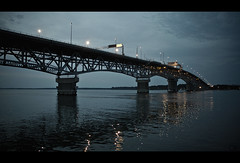 Steel Blue (Justin Wolfe) Tags: ocean wood bridge blue sunset sea fish cinema reflection film beach nature water night marina river dark movie boats lights virginia boat movement dock marine aqua waves natural ripple steel widescreen horizon deep h2o deck va land yorktown mast coleman aquatic cinematic seas colemanbridge