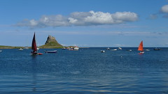 Summer (cycle.nut66) Tags: leica blue red sea summer sky orange sun house holiday green castle home clouds boats island fishing gun waves sailing sill harbour fort horizon battery sails calm panasonic holy summicron restoration win ouse sai lindisfarne lumic crag lx3 beblow