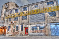 Cumberland Cement & Supply Co (podolux) Tags: door windows building abandoned window buildings md industrial doors maryland reddoor doorway forgotten 2009 cumberland dilapidated westernmaryland paintedwall paintedsign photomatix tonemapped paintedad tonemap cementcompany march2009 dwwg photomatixformac